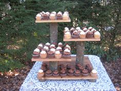 I love this layout, just replace the wood with game boards and they branches with.... something else. Rustic Wedding Cake Stand Cupcake Dessert by YourDivineAffair, $159.95