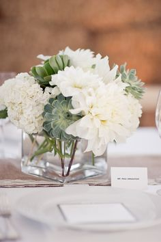 beautiful white florals with a succulent accents to create a chic and rustic look- Bridal Bliss Wedding