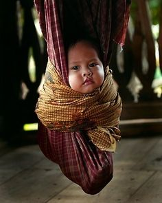 Hanging out ~ JILBAB STYLE  Poor thing looks like he's in a tightly wrapped cacoon!