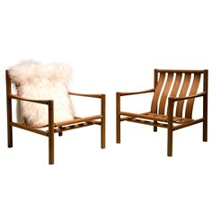 Pair of Handmade Slatted Oak Lounge Chairs by Jørgen Nilsson | See more antique and modern Lounge Chairs at https://www.1stdibs.com/furniture/seating/lounge-chairs