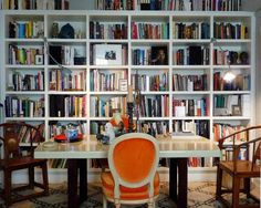 The bookcases in Ahmad Sardar's New York apartment are stocked not just with books, but with all kinds of art and objects.