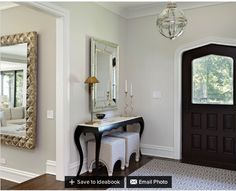 Hall walls in Benjamin Moore Classic Gray  The Living Room is Benjamin Moore London Fog  Cooper Console Table from Currey and Company. Light from Restoration Hardware