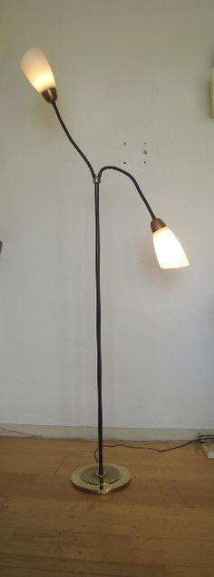 Midcentury floor lamp from the Yellow and red brass and black lacquered iron parts. White glass shades on goosnecks that allow the shades to be put in any position desired. In perfect condition. E 27 lamp sockets. Lamp, Desk Lamp, Lamp Socket, Floor Lamp, Mid Century Floor Lamps, Glass Shades, Vintage Designs, White Glass, Home Decor