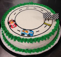 Racing car DQ ice cream cake with gel track and grass border.
