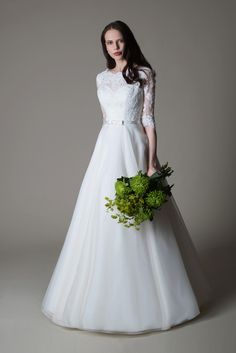 Magdalene is a gorgeous full organza skirted A line wedding gown with the prettiest embellished lace bodice with 3/4 length sleeves.