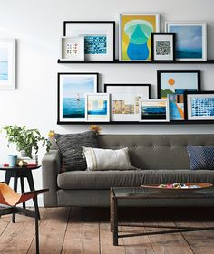 Gallery Wall: Leaning on Ledges | This display is easily adaptable, so you can add pieces or shift them around when you want. Here's the how-to, plus information on the art shown.