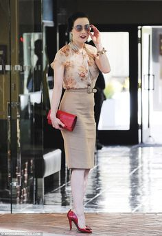 Retro and ravishing: Dita Von Teese looked feminine in her floral blouse and pencil line beige skirt that evoked Hollywood in the 1940s