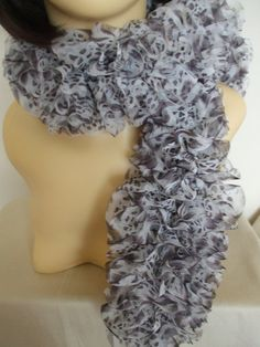 Knitted Frilly Ribbon Scarf in Brown & White Ocelot Print £13.00