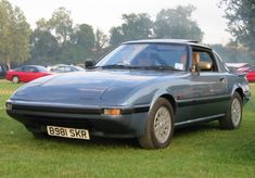 alex's 1985 slate blue RX7 - seats so low slung they might as well be cushions at a japanese tea house.