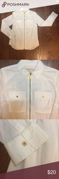 Michael Kors gold zipper shirt Size small. Some signs of wear (see pictures) but dry cleaning should freshen it right up! Too small for me now! Michael Kors Tops