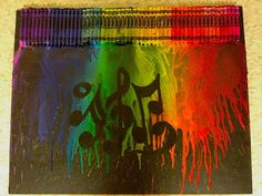I've seen some of these crayon melting art pieces before, but I like this one having the musical notes image in it