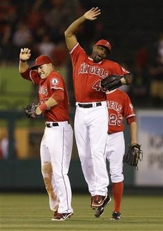 Los Angeles Angels center fielder Mike Trout, left, and right fielder Torii Hunter celebrate their win against the Baltimore Orioles during a baseball game in Anaheim, Calif., Thursday, July 5, 2012. (AP Photo/Chris Carlson)