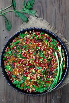 Easy jeweled couscous recipe! Packed with warm Mediterranean flavors, and pomegranates, nuts, raisins, and even lentils! Vegan side dish or salad!