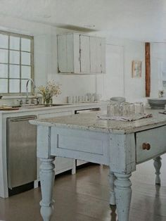 rustic white kitchen. in love with it. all it needs is wooden cabinet door knobs