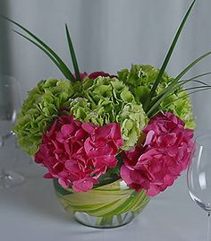 The striking visual contrast of green and hot pink hydrangea makes for an elegant and sophisticated choice. Use of bear grass adds visual texture. Pink Hydrangea Centerpieces, Green Hydrangea, Wedding Centerpieces, Hydrangeas, Table Flowers, Love Flowers, Spring Flowers, Beautiful Flowers, Spring Colors