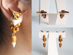 handmade eevee pokemon earrings out of pearl polymer clay so this pair is glittering!on sale at: https://www.etsy.com/listing/161465802/eevee-pokemon-earrings