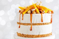 Mango, coconut and macadamia ice cream layer cake with chilled lime caramel. This spectacular dessert can be layered up or layered down, and dressed with any other seasonal fruit with a tropical twist. Begin this recipe 1 day ahead.