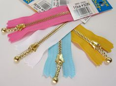 Sweet Japanese zippers with gold pulls -- listed in my Etsy shop.