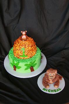 Monkey Sitting On Mound Of Bananas With Smash Cake