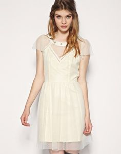 I love this lace dress. I'd throw a ton of bangles on my arm and pin my hair up to dress it up!