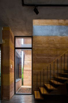 Vo Trong Nghia Architects has completed a house in Hanoi featuring walls made from different types of rammed earth, and gabled roofs incorporating planters. Pavilion Architecture, Sustainable Architecture, Residential Architecture, Contemporary Architecture, Architecture Details, Landscape Architecture, Rammed Earth Homes, Rammed Earth Wall, Great Buildings And Structures