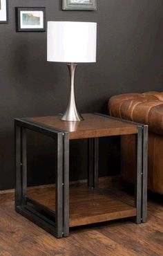 The Noho End Table turns heads with its mixture of industrial and rustic style and features modern, neutral colors. It's both interesting and functional, with its riveted metal frame and convenient storage shelf.