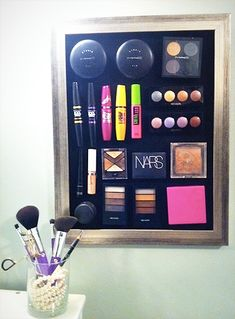 Make-up organization. Simply hang a sheet of metal (even a baking sheet pan will work) attach some adhesive magnets to your make-up and hand from the sheet.