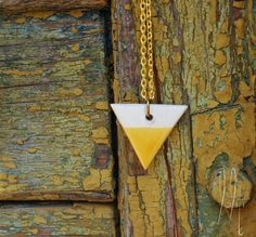 Items similar to Geometric ceramic triangle pendant with long chain, long necklace with triangle, two color, mustard yellow and white on Etsy Ceramic Jewelry, Arrow Necklace, Triangle, Ceramics, Free Shipping, Yellow, Pendant, Unique Jewelry, Handmade Gifts