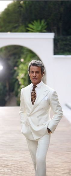 White suit with patterned tie #whitesuit