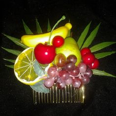 Tropical fruit haircomb....this tuttyfruity piece is selling for $15 plus shipping leave your email to purchase. #deadlydinaaccessories #carmenmirandainspired #fruit #tropicalbeach #tropical #luau #hawaiin #tiki #tikioasis #hairflowers #hairpiece #hairaccessories #haircomb #pinup #retro