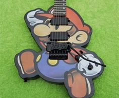 """Mario would have """"saved"""" the Princess a lot sooner had he been able to challenge Ludwig Von Koopa in a musical standoff with the powerful Super Mario guitar in his capable hands. Apart from its ability to deafen Koopas, the guitar is a quality instrument any geeky rocker would be lucky to wail on. With…"""