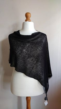 Check out this item in my Etsy shop https://www.etsy.com/uk/listing/513193084/black-spanish-style-boho-chic-poncho