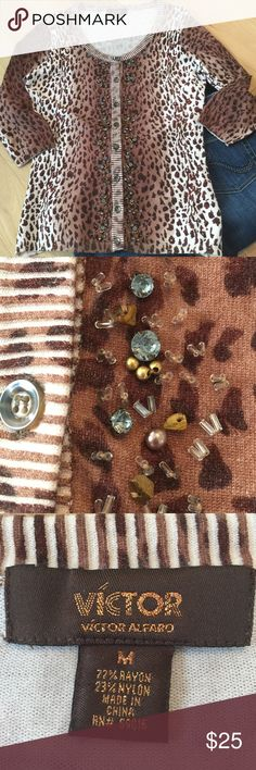 Leopard Cardigan Such a rare find! Was not familiar with this designer but so impressed by the detail on this garment. Apparently this brand is sold at Nordstrom according to their current website. Beautiful lightweight v-neck cardigan sweater with pewter rhinestones, gold beading, and tiger eye gemstone beads. Very unusual-the style is long but probably not leggings long unless you are petite. 🐯 ROAR! GUC - possibly vintage...? Victor Alfaro Sweaters Cardigans