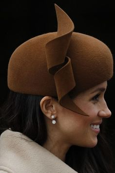 Meghan Markle wore a hat by Philip Treacy and diamond earrings from Birks to the Royal Family's traditional Christmas Day service at St Mary Magdalene Church in Sandringham, Norfolk, eastern England, on December Photo ADRIAN DENNIS/AFP/Getty Images Cartier Earrings, Dainty Earrings, Stud Earrings, Jacket Earrings, Diamond Earrings, Meghan Markle Wedding, Meghan Markle Style, Princess Meghan, Prince Harry And Meghan