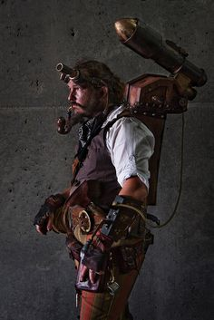 Steampunk man with... I think... a rocket launcher??  Sweet.