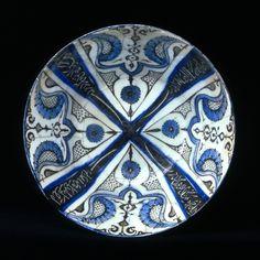 Fritware bowl, painted in black and blue under a transparent glaze Iran, Kashan; beginning of 13th century H: 10; Diam: 21 cm http://www.davidmus.dk/en/collections/islamic/materials/ceramics