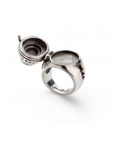 I have this ring and LOVE it! The Borgia Ring by Jewelmint.com shown opened to reveal it's secret compartment!