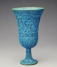 Egyptian Faience Lotiform Cup, c.945–715 BC, 22nd Dynasty ( The Met )  This cup, made of brilliantly glazed Egyptian faience, imitates the slender form of the flower and is decorated in relief with scenes depicting the plant's marshy habitat. Such cups were funerary offerings made to be placed in tombs.