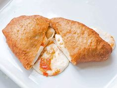 Italian panzerotti are semi-circular pockets of bread that are usually filled with cheese, deep-fried, and eaten hot.