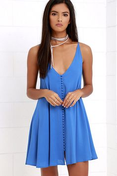 A lady as lovely as you surely deserves the Cute as a Button Blue Swing Dress! From adjustable spaghetti straps, lightweight rayon sweeps into a triangle bodice and swing silhouette with full, loop button placket.