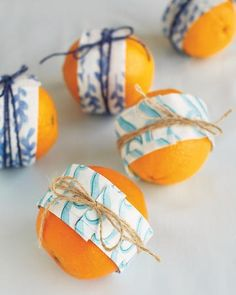 super cute, adaptive, and inexpensive favor idea ... can mix up with different wrapping (papers, fabric, etc), binding materials (ribbons, twine, etc), tags, or fruits (apple, orange, pear, etc)