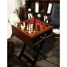 There's more than just chess to this coolly refined little game table. Game tables made for Armies on the move always served multiple functions: end table, shaving bench, breakfast plateau...Two drawers hold chess and checker game sets. Or socks and ties. Check out more details at Mandoras.com.