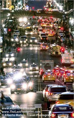 Dense traffic in the 42nd street at dusk, Manhattan, New York. | By Alberto Mateo, Travel Photographer.