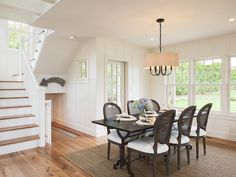 Elegant+dining+room+features+vertical+paneled+walls+alongside+a+Restoration+Hardware+Bluestone+