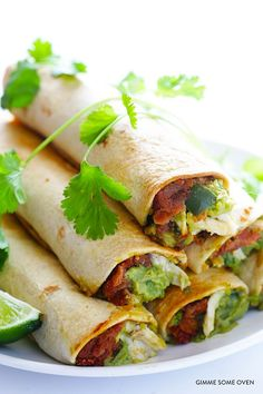 All you need are 5 ingredients to make these tasty chicken guacamole taquitos!   gimmesomeoven.com