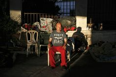 Giorgos, 50, sits with his belongings under a bridge, where he lives with a group of other homeless people, in central Athens on May 25, 2013. Giorgos was forced to close down the billiard hall he owned in 2006 and spent time in prison for not paying his social security debts.
