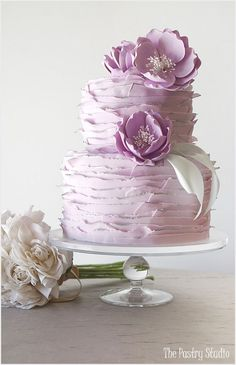 Romantic Lilac Ruffle-Wrapped Wedding Cake with Lavender Flowers / http://www.deerpearlflowers.com/32-wedding-cakes-with-classical-details/