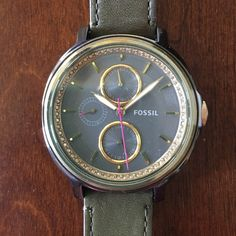 Olive Colored leather Fossil watch Olive green, leather band Fossil watch with an olive and gold face. Around the face there is a line of jewels! Super cute adjustable watch Fossil Accessories Watches