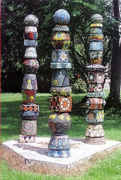 Fabulous totem poles what a great idea for the garden.