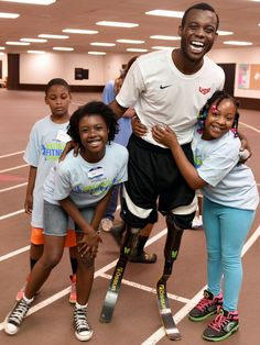 Kids from Boys & Girls Clubs of Cleveland celebrate after running with Paralympic athlete Blake Leeper during Boys & Girls Clubs of America's National Fitness Competition sponsored by Nestle in suburban Cleveland, Ohio.   Jason Miller, AP Images for Boys & Girls Clubs of America